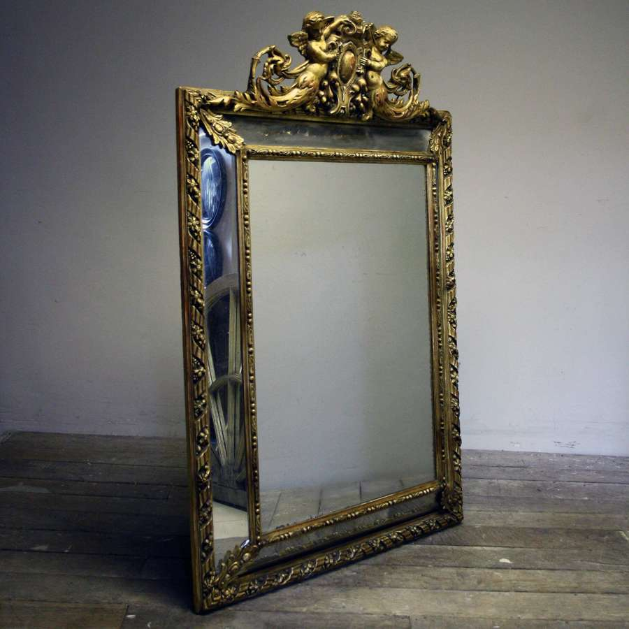A 20th Century carved wood and gesso Cushion mirror
