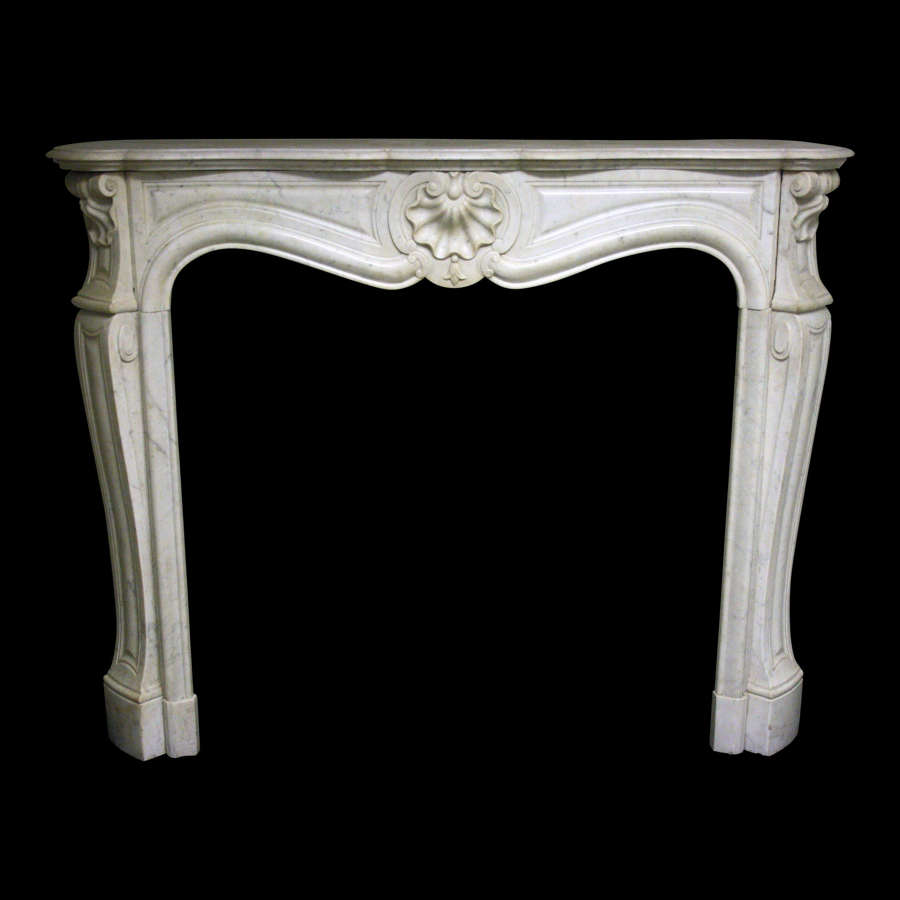 A 19th Century French Chimneypiece in marble in the Louis XV manner.