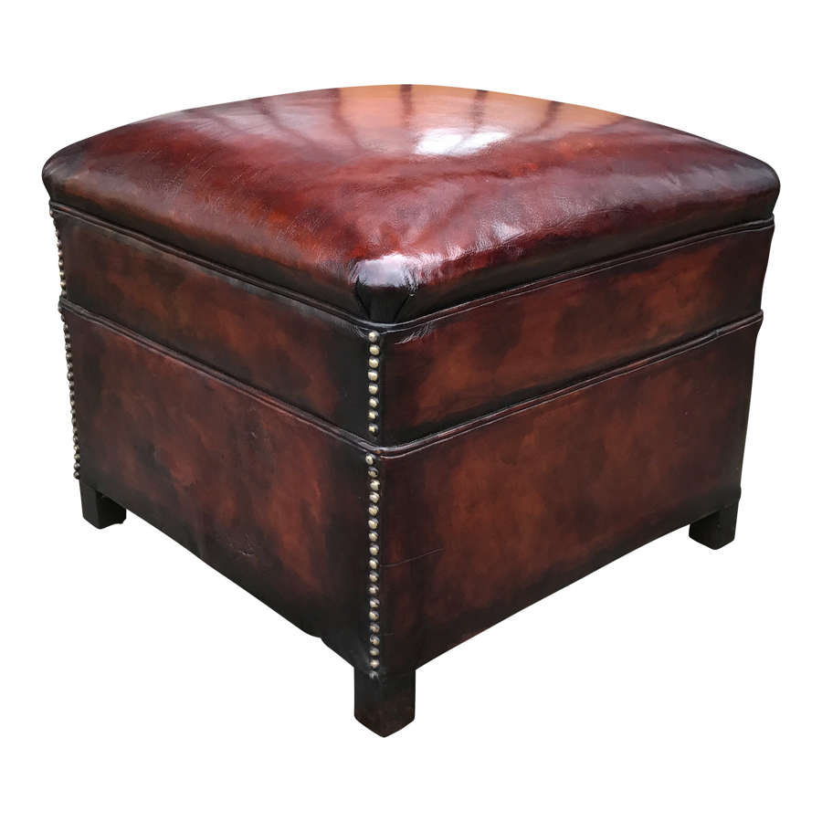 A stunning mid 20th Century studded conker brown leather footstool