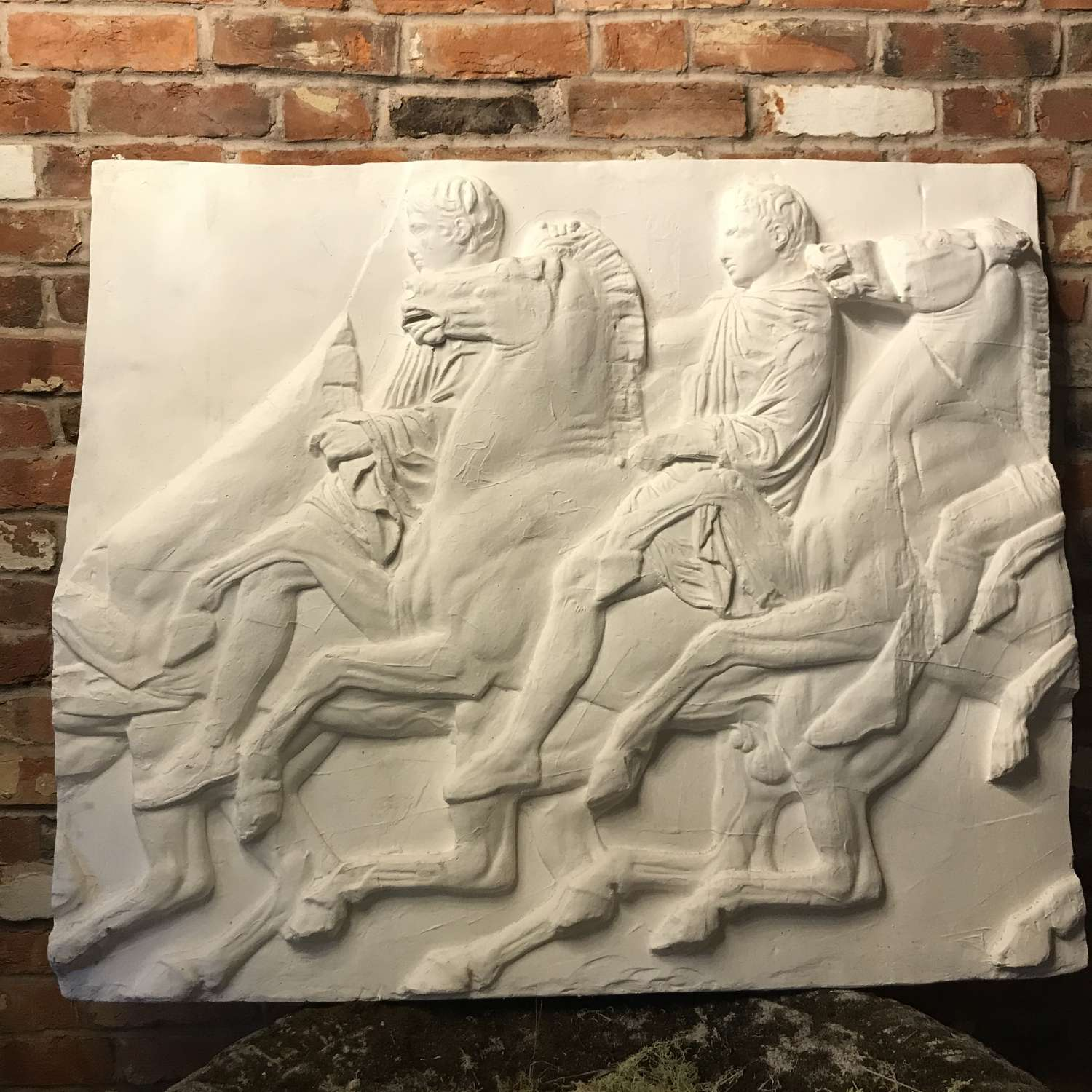 A plaster Panel of a section of the Parthenon Frieze