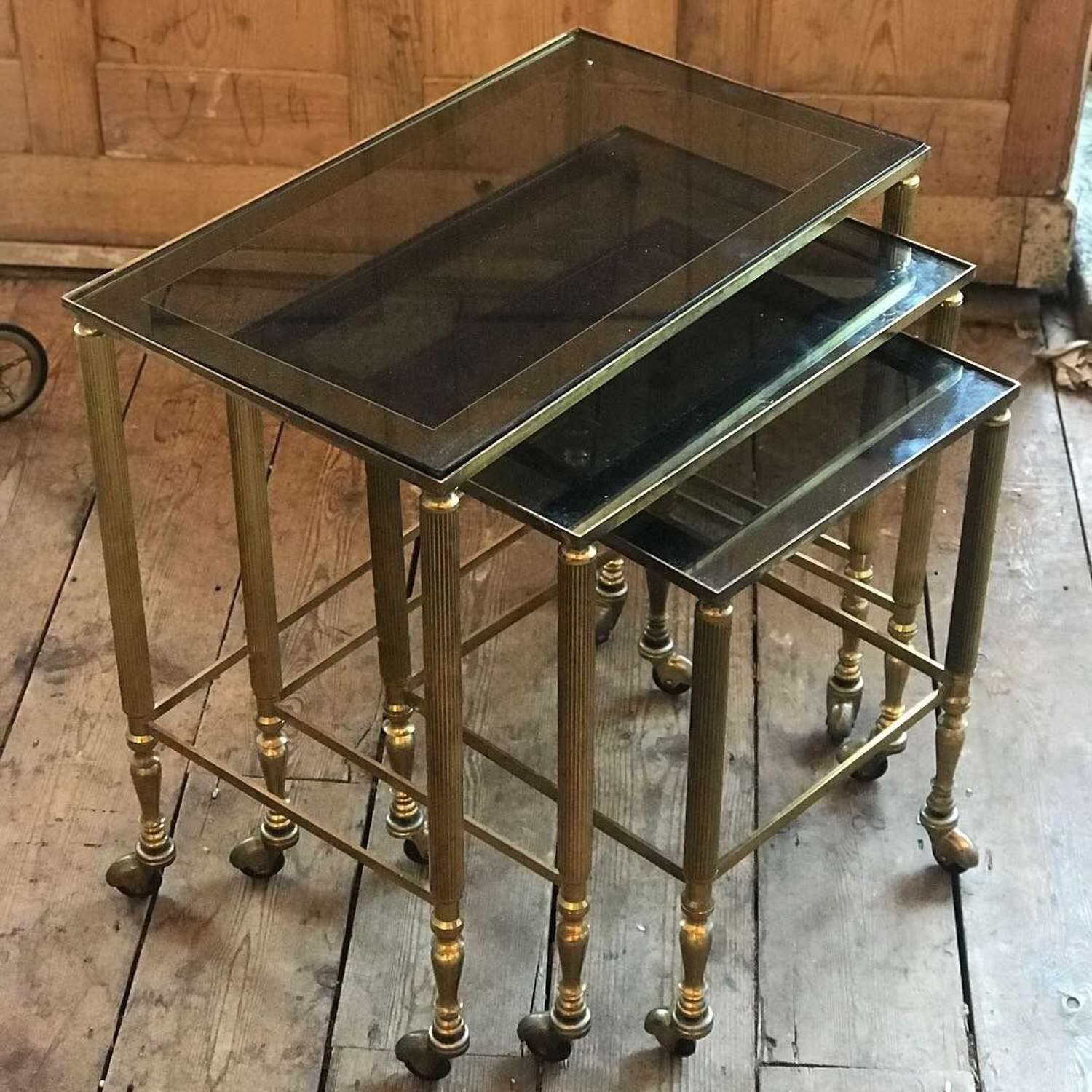 20th Century Brass nest of tables on wheels